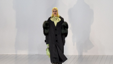 Lady Gaga rocks the runway in a large trench coat