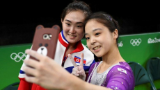 North and South Korean gymnasts pose for Olympic selfie