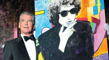"""Pierce Brosnan """"Gobsmacked"""" After His Bob Dylan Painting Sells for $1.4M"""