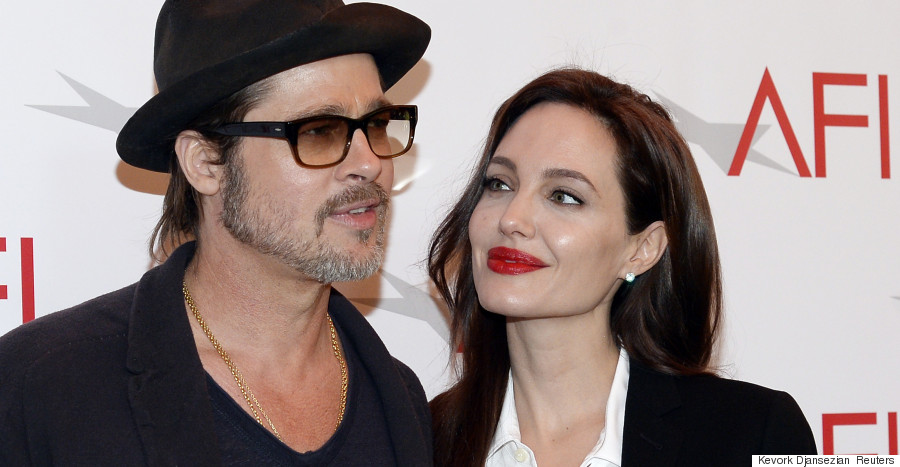 Actor Brad Pitt and actress/director Angelina Jolie pose at the AFI Awards 2014 honoring excellence in film and television in Beverly Hills, California on January 9, 2015. REUTERS/Kevork Djansezian  (UNITED STATES - Tags: ENTERTAINMENT)