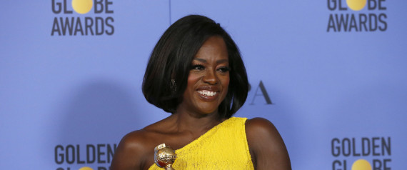 """Viola Davis holds the award for Best Performance by an Actress in a Supporting Role in any Motion Picture for her role in """"Fences"""" during the 74th Annual Golden Globe Awards in Beverly Hills, California, U.S., January 8, 2017.   REUTERS/Mario Anzuoni"""