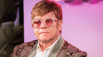Elton John tearfully escorted off stage after losing his voice mid-concert