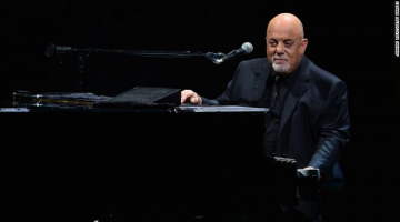 Billy Joel playing a discarded piano is the happy we need right now
