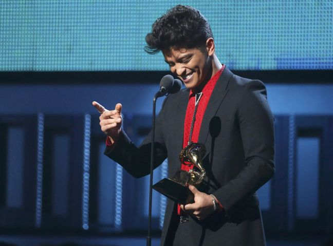 """Bruno Mars accepts the award for Best Pop Vocal Album for """"Unorthodox Jukebox"""" at the 56th annual Grammy Awards in Los Angeles"""