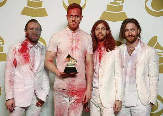"""Rock band Imagine Dragons pose backstage with the award they won for Best Rock Performance for """"Radioactive"""" at the 56th annual Grammy Awards in Los Angeles"""