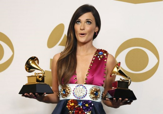 """Country singer Kacey Musgraves poses backstage with her awards for Best Country Song for """"Merry Go 'Round"""" and Best Country Album for """"Same Trailer Different Park"""" at the 56th annual Grammy Awards in Los Angeles"""