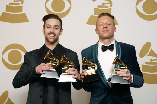 """Hip hop artists Macklemore and Lewis pose backstage with their awards for Best New Artist, Best Rap Performance for """"Thrift Shop"""", Best Rap Song for """"Thrift Shop"""" and Best Rap Album for """"The Heist"""" at the 56th annual Grammy Awards in Los Angeles"""