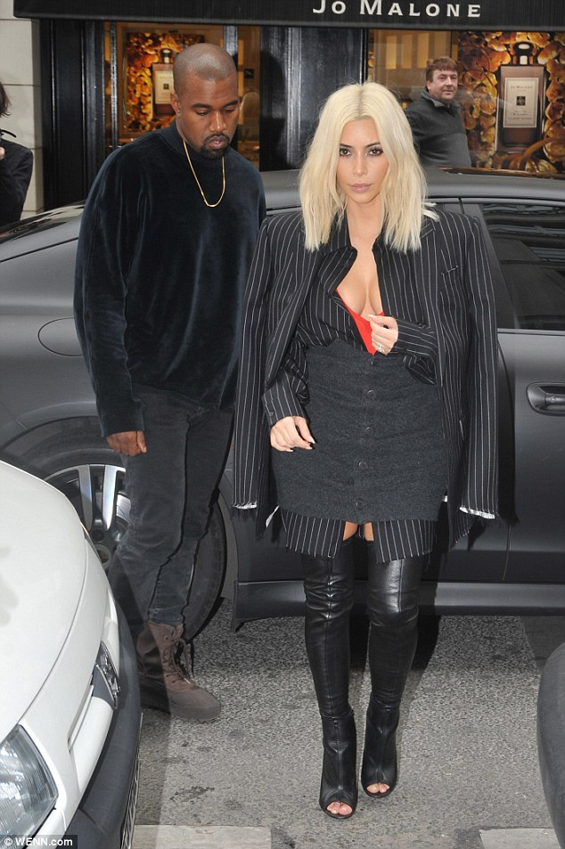 2679093500000578-2986480-All_eyes_on_Kim_Kim_Kardashian_experiments_with_a_pinstripe_outf-a-155_1425912266898