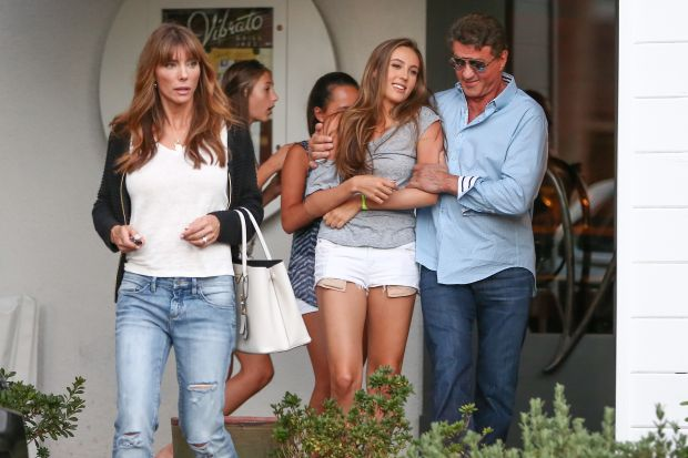 UK CLIENTS MUST CREDIT: AKM-GSI ONLY EXCLUSIVE: 'The Expendables 3' star Sylvester Stallone is all smiles as he steps out with his wife Jennifer Flavin and his daughters Scarlet, Sophia and Sistine to enjoy a family lunch at SHU Sushi House Unico in Beverly Hills, CA. Pictured: Sylvester Stallone and Jennifer Flavin Ref: SPL822085  150814   EXCLUSIVE Picture by: AKM-GSI / Splash News Splash News and Pictures Los Angeles:310-821-2666 New York:212-619-2666 London:870-934-2666 photodesk@splashnews.com