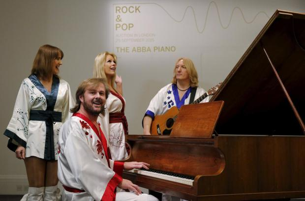 cast-members-of-the-abba-inspired-musical-bjorn-again-perform-at-a-grand-piano-made-by-georg-bolin-and-used-by-the-swedish-pop-group-abba-to-recorded-many-of-their-hit-songs-at-sothebys-auction-ho1