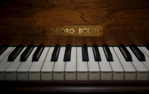 keys-and-the-name-plate-are-seen-on-the-a-grand-piano-made-by-georg-bolin-and-used-by-the-swedish-pop-group-abba-to-recorded-many-of-their-hit-songs-at-sothebys-auction-house-in-london-britain