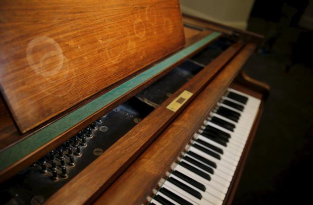 stains-are-seen-on-the-a-grand-piano-made-by-georg-bolin-and-used-by-the-swedish-pop-group-abba-to-recorded-many-of-their-hit-songs-at-sothebys-auction-house-in-london-britain