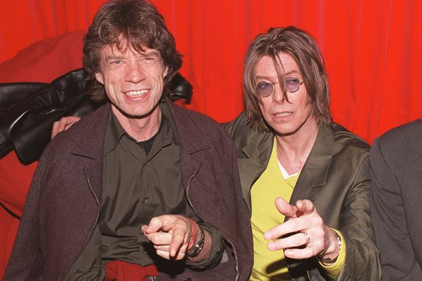 Singers-David-Bowie-R-and-Mick-Jagger-L-at-POP-in-Soho-London
